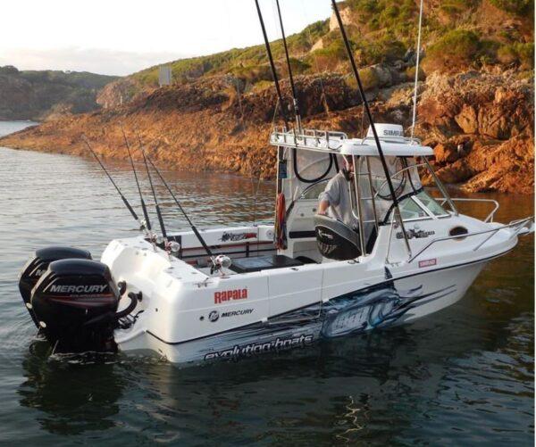 marlin half boat wrap shown on a boat in water