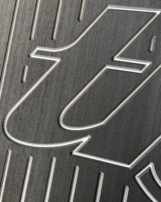 custom routed logo in udek marine flooring